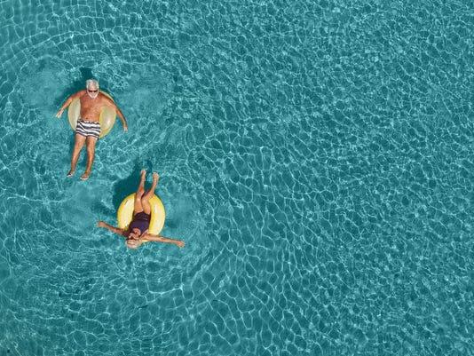 Senior couple having fun in the sea