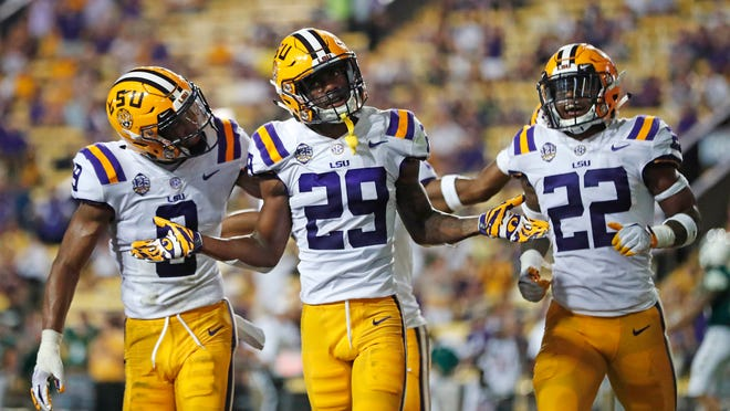FILE - In this Sept. 8, 2018, file photo, LSU cornerback Greedy Williams (29) celebrates his interception with safety Grant Delpit (9) and cornerback Kristian Fulton (22) in the second half of an NCAA college football game against Southeastern Louisiana, in Baton Rouge, La. Mississippi's strength is its passing game. No. 5 LSU's defense is known for stopping the pass. Both teams know that whoever controls that aspect of the game has a good shot at walking off the field with a win. (AP Photo/Gerald Herbert, File)