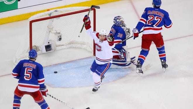 Canadiens right wing Brendan Gallagher   celebrates after a goal is scored by teammate Andrei Markov  past  Rangers goalie Henrik Lundqvist during the second period in Game 3 of the Eastern Conference finals at Madison Square Garden Thurday night.
