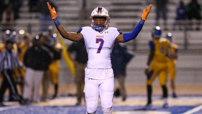 Madison Central's Quentin Euell (7) reacts after Braden Boykin's (6) interception returned or a touchdown during game action against the Tupelo Golden Wave in Tupelo, MS, on November 18, 2016.