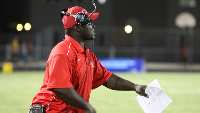 South Fort Myers Defensive Coordinator Anthony Dixon coaches his team Thursday Sept. 16, 2010. against Cypress Lake High School.
