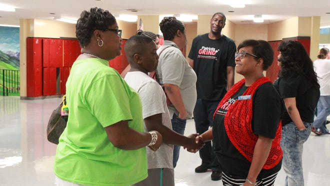 Tiffany Taylor, principal at North Parkway Middle School, meets student David Emerson at an open house Thursday.