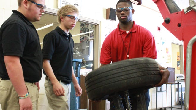 Students work in the auto shop during class at South Side High School.