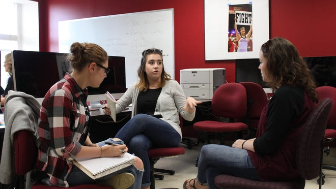 High school students Jerrica Voyles, 17, and Kailey McKee, 16, practice interviewing Kallan Parker, a senior at Union University.