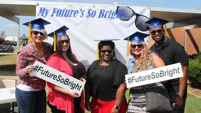 Farrah Lewis, Carla McCoy Davis, Erika Wilcox, Sarah Hopper and Hilton Graham pose Thursday at the Tennessee College of Applied Technology Jackson.