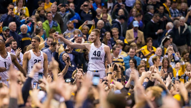Marquette Golden Eagles center Luke Fischer (40) celebrates with fans after the game against the Villanova Wildcats at BMO Harris Bradley Center. The Golden Eagles won 74-72.