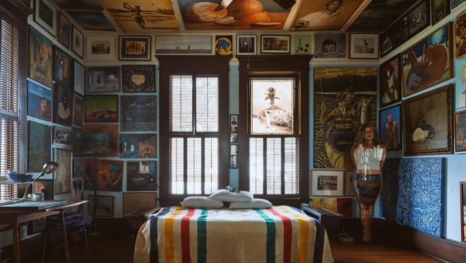 Former Texas Gov. Joseph Sayer's 1904 home is now filled with artwork. It's on the Preservation Austin virtual home tour of downtown spaces. The guest bedroom offers three-dimensional art as well as framed wall art.