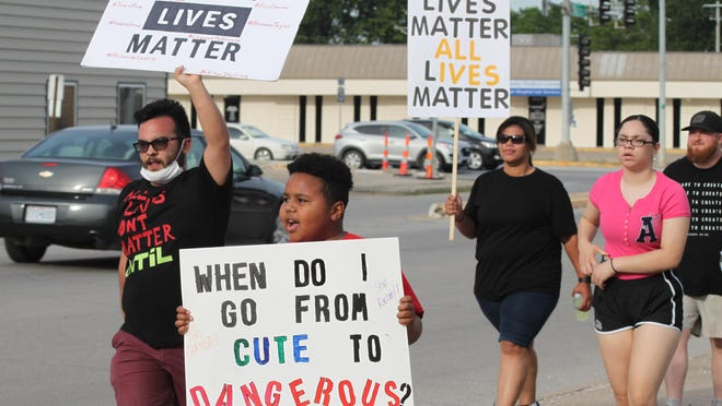 Protesters marched a several block radius Monday evening in downtown Moberly to speak out against nationwide police brutality in the wake of George Floyd's death.