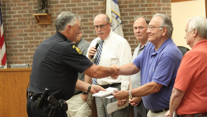 Moberly City Councilmen gave gift certificates to each city department head as a thank you to city employees for their work during the COVID-19 pandemic. Moberly Police Chief Troy Link accepts a certificate from Councilman John Kimmons.