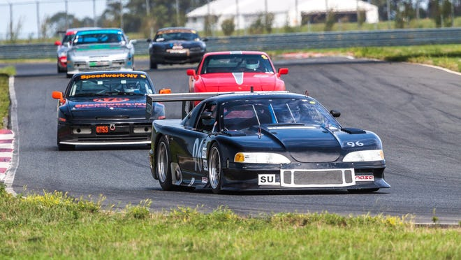 Cars race on the track at the New Jersey Motorsports Park in Millville.