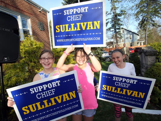 From left, Emily Goldsmith, 10, Shanna Goldsmith, 10, and Rosie O'Brien, 10, hold signs during suspended Clarkstown Police Chief Michael Sullivan press conference where he announces he is running for Clarkstown Supervisor at Congers Veterans Memorial Association in Congers April 17, 2017.