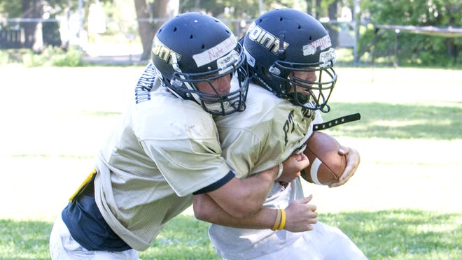Pt. Pleasant Boro football practice. John Youmans (right) is stopped by Nate Husak -  August 14, 2014 Pt. Pleasant NJ. Staff photographer/Bob Bielk/Asbury Park Press