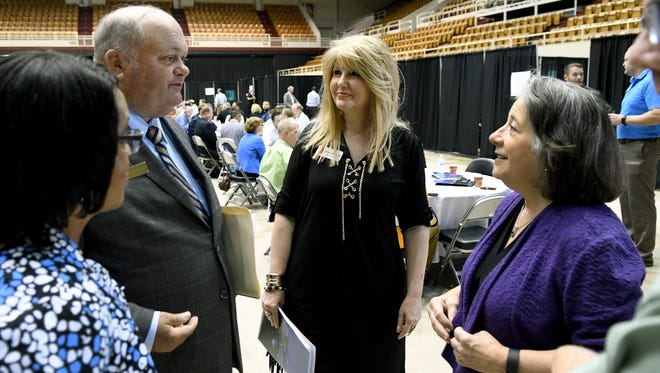 Mayor Madeline Rogero, right, talks to Pamela Cotham, left, Boyce Evans, second from left, and Jeanette Reynolds, with Edwards Supply, before the start of the City's ninth Òbusiness workshopÓ Wednesday, Jun. 14, 2017. The breakfast gives business owners the chance to learn how to bid on jobs from the city.