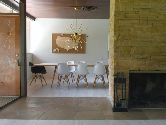 A pathway breaks up the space between two rooms and