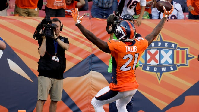 Denver Broncos cornerback Aqib Talib celebrates scoring after a interception during the second half in a NFL football game against the Indianapolis Colts, Sunday, Sept. 18, 2016, in Denver. (AP Photo/Jack Dempsey)