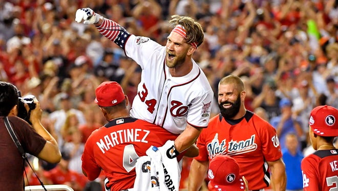 Bryce Harper celebrates with manager Dave Martinez after winning the Home Run Derby.