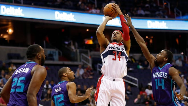 Washington Wizards forward Paul Pierce (34) shoots the ball over Charlotte Hornets forward Michael Kidd-Gilchrist (14) in the first quarter at Verizon Center.