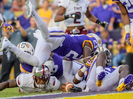 Troy wide receiver Emanuel Thompson (8) is stopped just shot of a touchdown by LSU linebacker Devin White (40) and linebacker Corey Thompson (23) in the first half of an NCAA college football game in Baton Rouge, La., Saturday, Sept. 30, 2017.