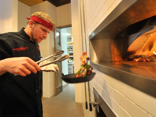 Chef Brandon McCormick-Guthu prepares vegetables for