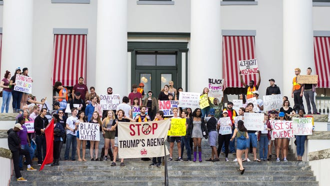 A group of people organized to protest President Donald Trump's Inauguration in front of the Old Capitol Building, Tallahassee, FL, on January 20th, 2017