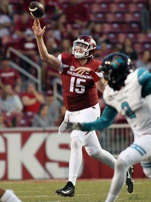 Arkansas quarterback Cole Kelley (15) passes on fourth down against the Coastal Carolina Chanticleers during the fourth quarter at Donald W. Reynolds Razorback Stadium.