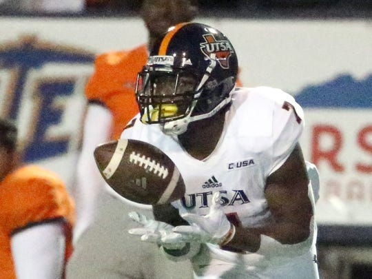 UTSA wide receiver Kerry Thomas Jr., 7, catches a long throw and ran it the rest of the way for a score against UTEP Saturday night in the Sun Bowl.