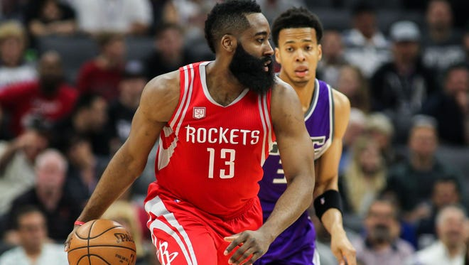 Houston Rockets guard James Harden (13) dribbles the ball past Sacramento Kings forward Skal Labissiere (3) at Golden 1 Center.
