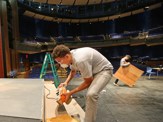 Chaim Tillinghast, 15, a 10th grader at The School for Creative and Performing Arts, works on the stage in the Corbett Theatre for the upcoming production of 'Joseph & The Amazing Technicolor Dreamcoat'. The show is Nov. 6-9.
