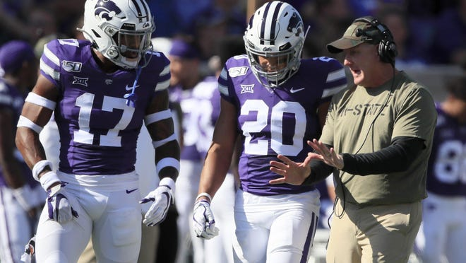 Kansas State coach Chris Klieman, with defensive backs Jonathan Alexander (17) and Denzel Goolsby (20) during the Baylor game last season, said he supports his players in their fight for progress on racial issues.
