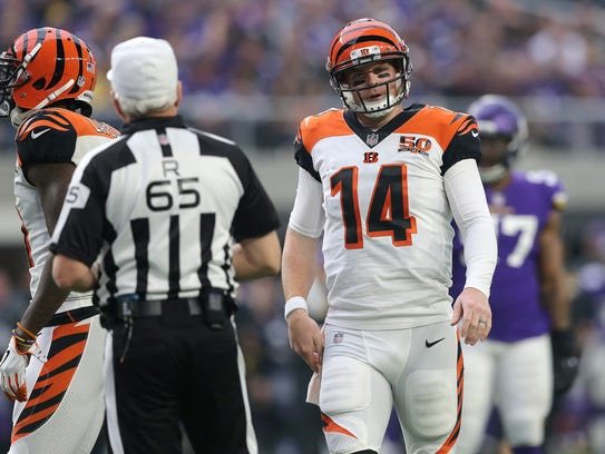 Cincinnati Bengals quarterback Andy Dalton (14) reacts
