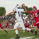 Granville wide receiver Jack Peterson attempts to haul in a pass before being hit by a River Valley defender during the Blue Aces' 2014 season opener.