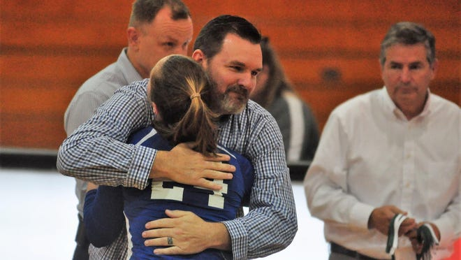 Fall sports at Somersworth High School are good to go, according to Somersworth AD and volleyball coach Steve Hodsdon, pictured here hugging a player following the 2016 Division II volleyball state championship match. The School Board approved practices and games on Monday.
