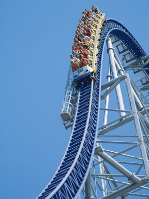 Wild ride: Thrill seekers fly downhill at top speeds of 90 mph on Millennium Force.  [Via MerlinFTP Drop]