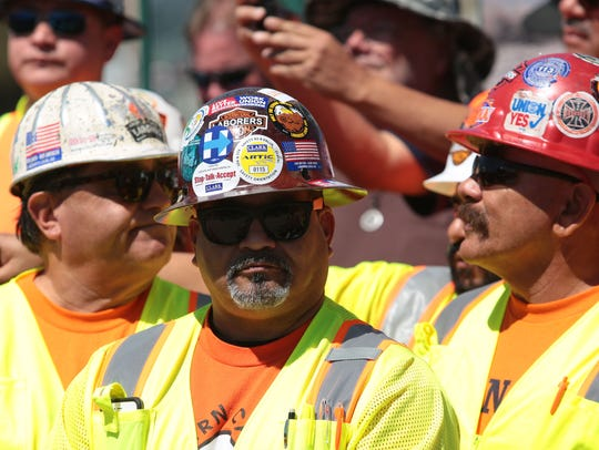 Workers stand behind California Governor Jerry Brown,