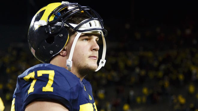 Michigan Wolverines offensive linesman Taylor Lewan (77) walks off the field after the game against the Nebraska Cornhuskers at Michigan Stadium on Nov. 9, 2013.
