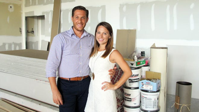 Brian and Nicole Roland stand in the space that will be Venue Naples, the fully customizable event space they are building on U.S. 41 in North Naples.