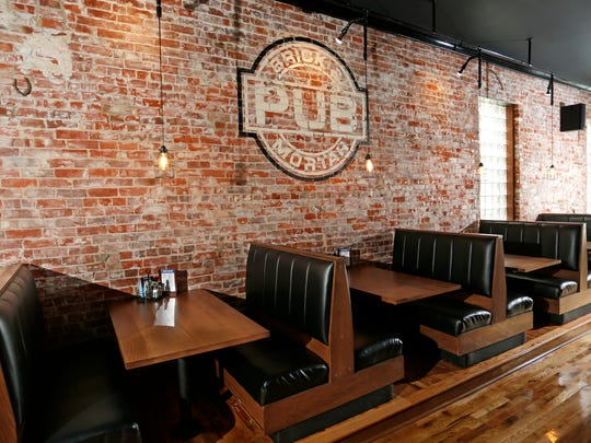 Hardwood floors and the original brick walls grace the interior of the Brick & Mortar Pub Wednesday, September 28, 2016, at 114 Main Street in Delphi. Booths, tables and the bar provide ample seating for patrons.