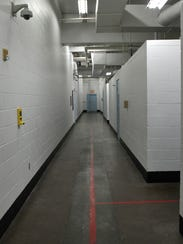 Corridors separate jail cells for lower and higher