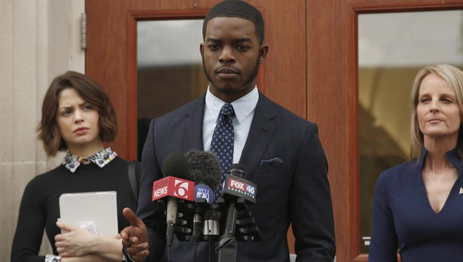 "Preston Terry (Stephan James) holds a news conference with Sarah (Conor Leslie) and Gov. Eamons (Helen Hunt) in Episode 1 of ""Shots Fired."""