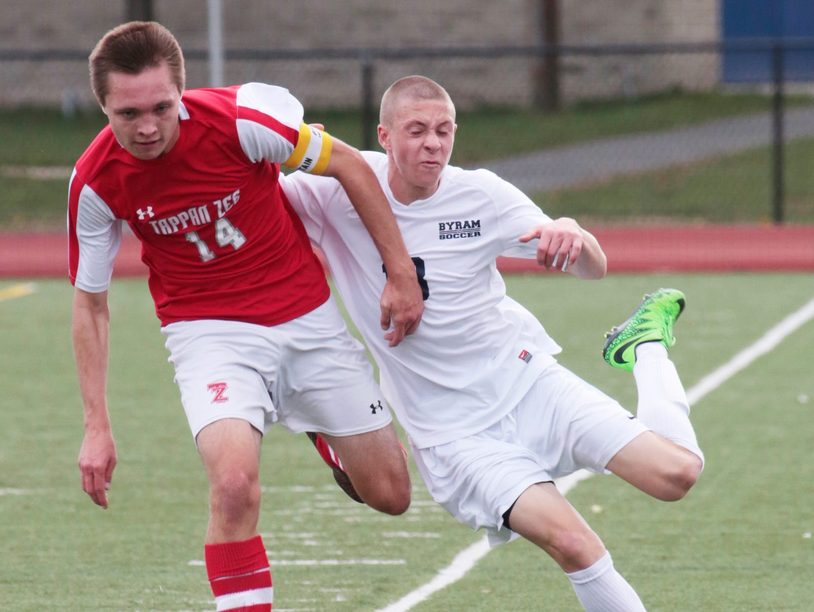 Tappan Zee's Lukas Puris (14) and Byrum Hills' David Noel (13) battle for possession of the ball during the game at Byrum Hills High School in Armonk on Oct. 29, 2015.