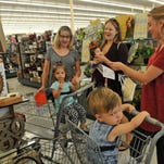 Out shopping with the ladies. One year old Isaiah Magnuson gives a look that suggests that he just knows that he's going to be in this store for a very long time. The new Hobby Lobby at Titus Landing Shopping Center in Titusville had it's Grand Opening on Monday, after a soft opening last week. The approx. 56,000 sq.ft. craft and home decor store drew a large crowd.