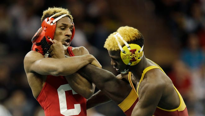 Cornell's Nahshon Garrett, left, grabs the leg of Iowa State's Earl Hall in a 133-pound match during the NCAA Division 1 wrestling championship in New York, Friday, March 18, 2016.
