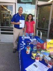 Allstate Exclusive Agent Barry Brikowski (left) of Old Bridge, with administrative assistant Shweta Shewale, collects donations for Middlesex County Food Organization and Outreach Distribution Services (MCFOODS) to help local families in need.