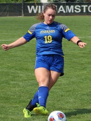 Sophomore Anna Leonard (19) was a tower of strength at center defense for Marian which allowed just three goals in seven playoff games.