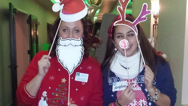 Guests show off their tackiest holiday sweaters at CURE's 2014 party.