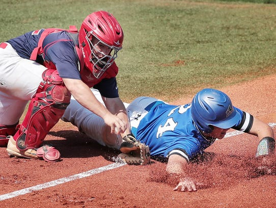 Tipton-Rosemark catcher Alex Langford tags out Christian