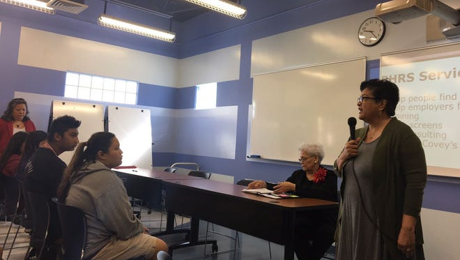 Chief Operating Officer/General Manager of Pacific Human Resource Services, Grace Donaldson speaks to participants at Guam Community College during PHRS the presentation about training students with disabilities.