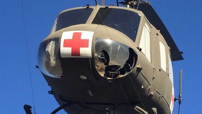 The downward vision window of a Huey mounted above the Vietnam War Memorial at Veterans Memorial Park in Las Cruces is damaged on Friday, May 18, 2018.