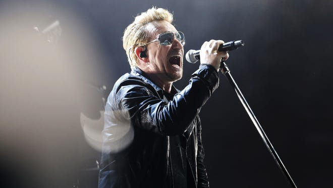 Bono performs with the band U2 on stage at the Bercy Accordhotels Arena in Paris on December 6, 2015.