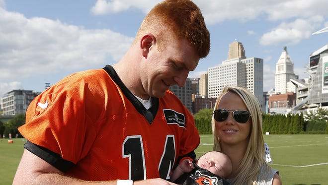 Cincinnati Bengals quarterback Andy Dalton and his three-week-old baby Noah along with his wife Jordan got together after practice at training camp downtown.